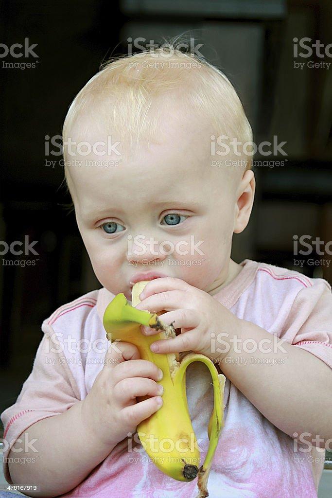 Baby Eating Banana royalty-free stock photo