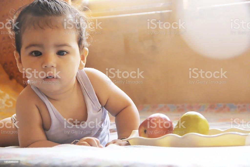 Baby Eating Fruits stock photo
