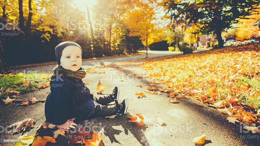 Baby Enjoying Autumn colors stock photo