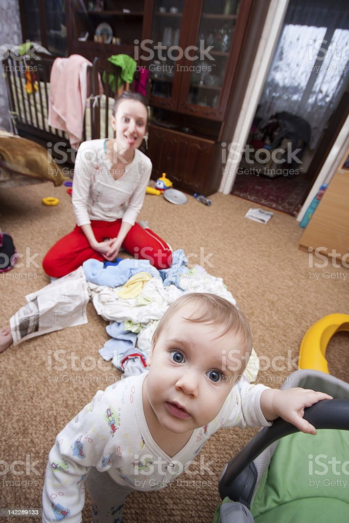 Baby escaping from crazy mother royalty-free stock photo