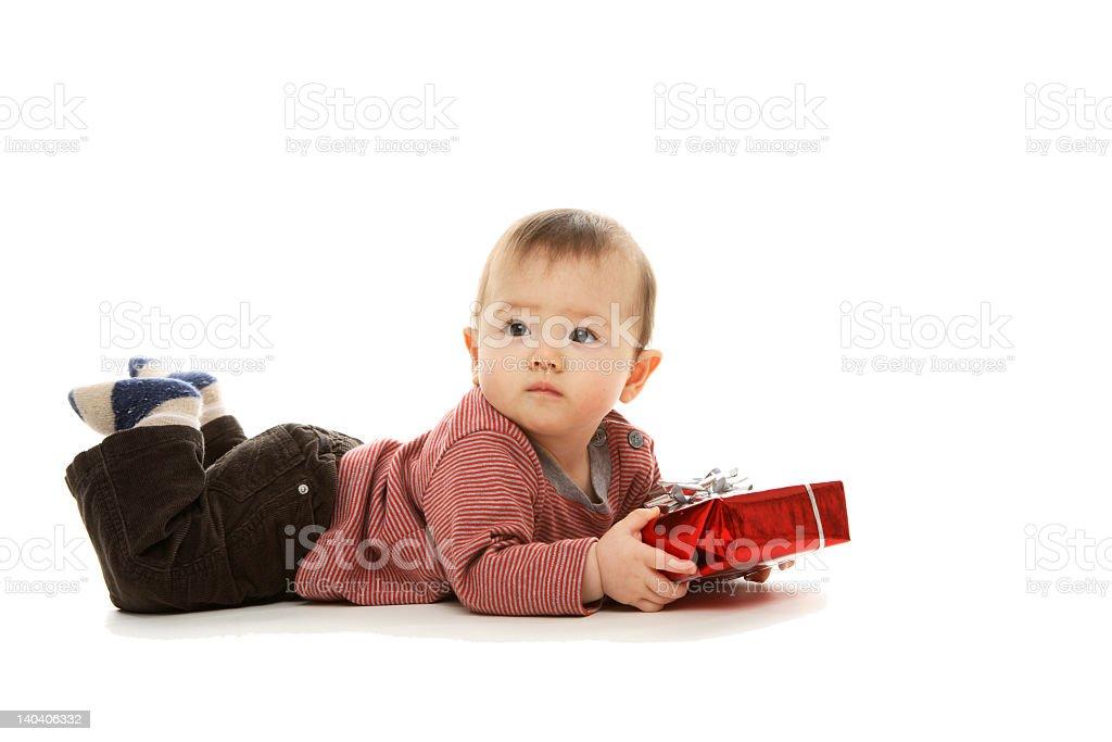 Baby examines a present. royalty-free stock photo