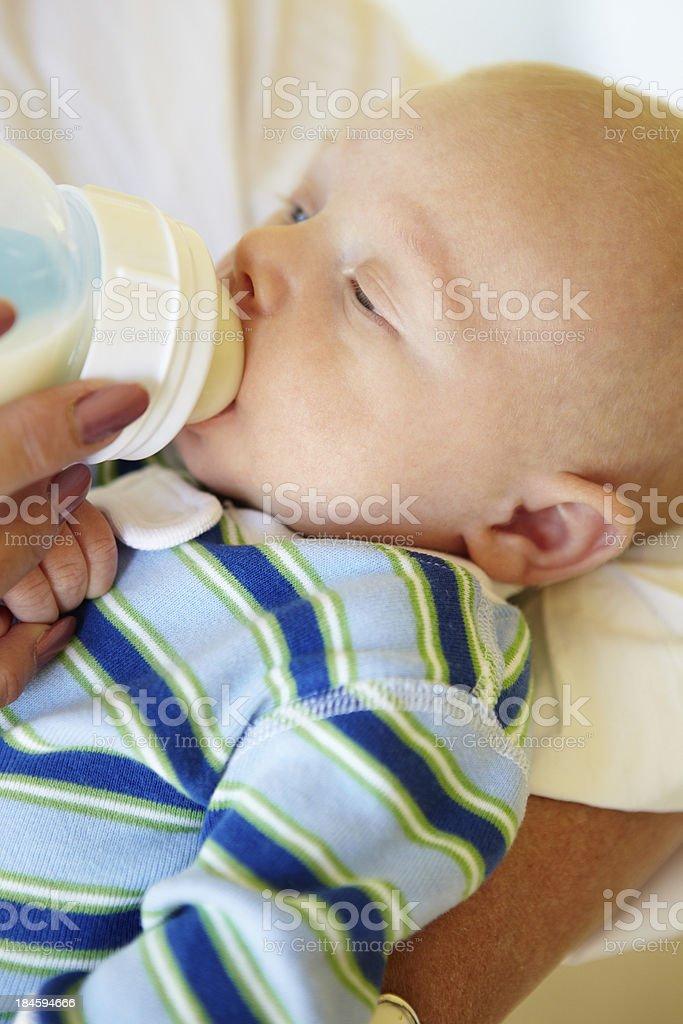 Baby feeding from bottle stock photo