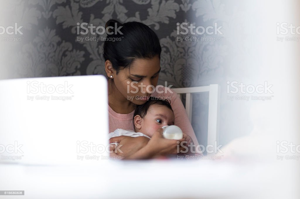 Baby feeding time stock photo