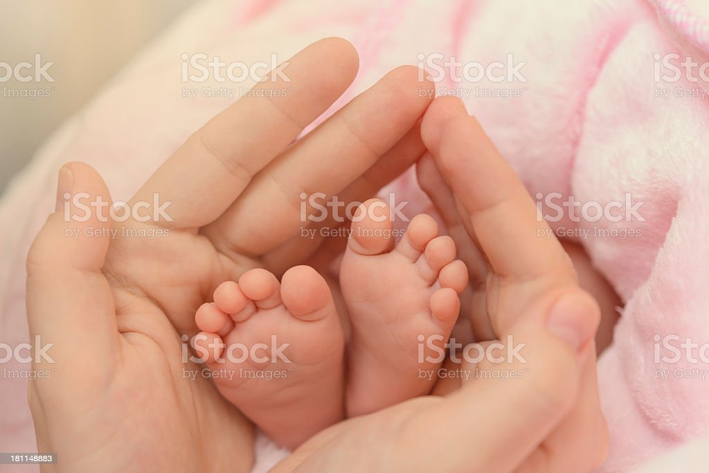 baby feel in her mom's hands royalty-free stock photo