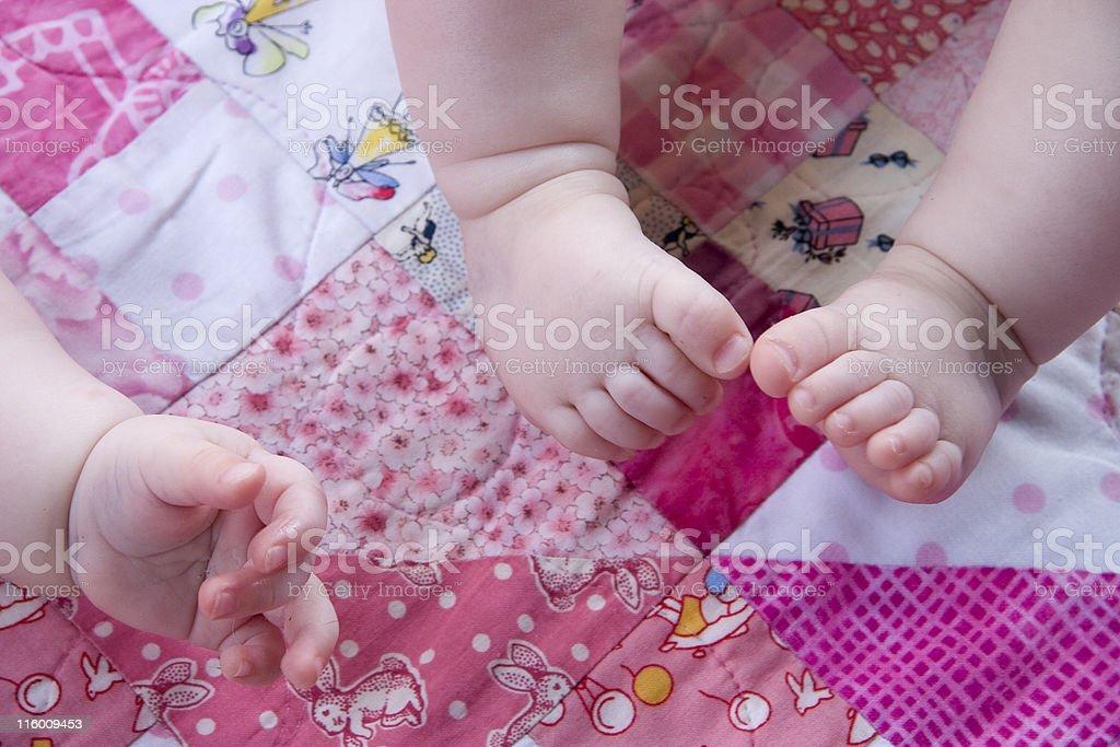 baby feet and hand stock photo