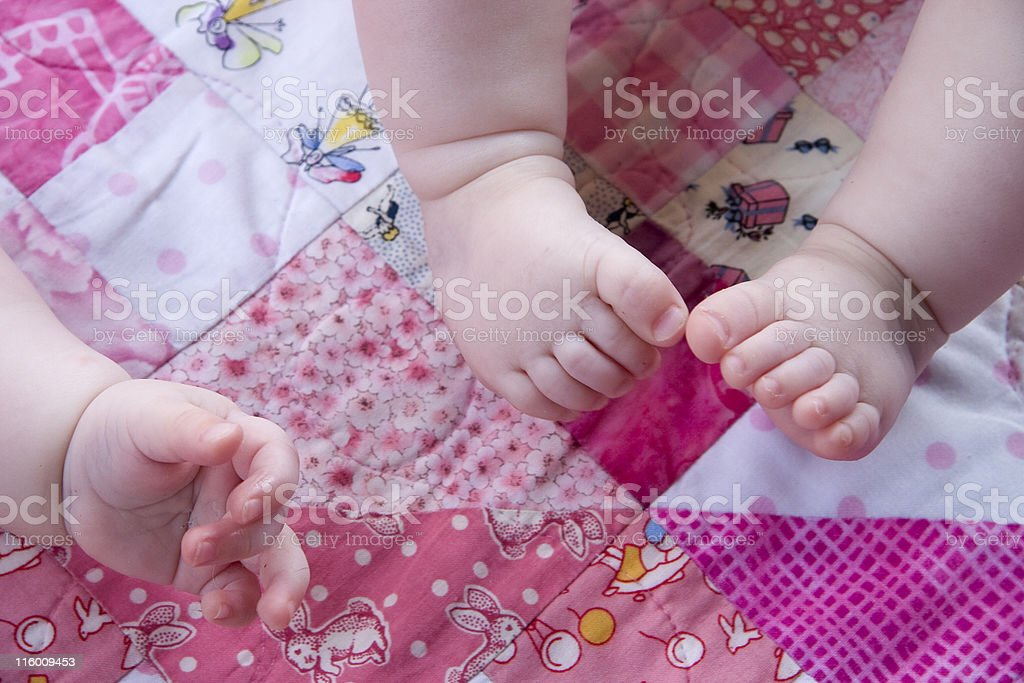 baby feet and hand stock photo