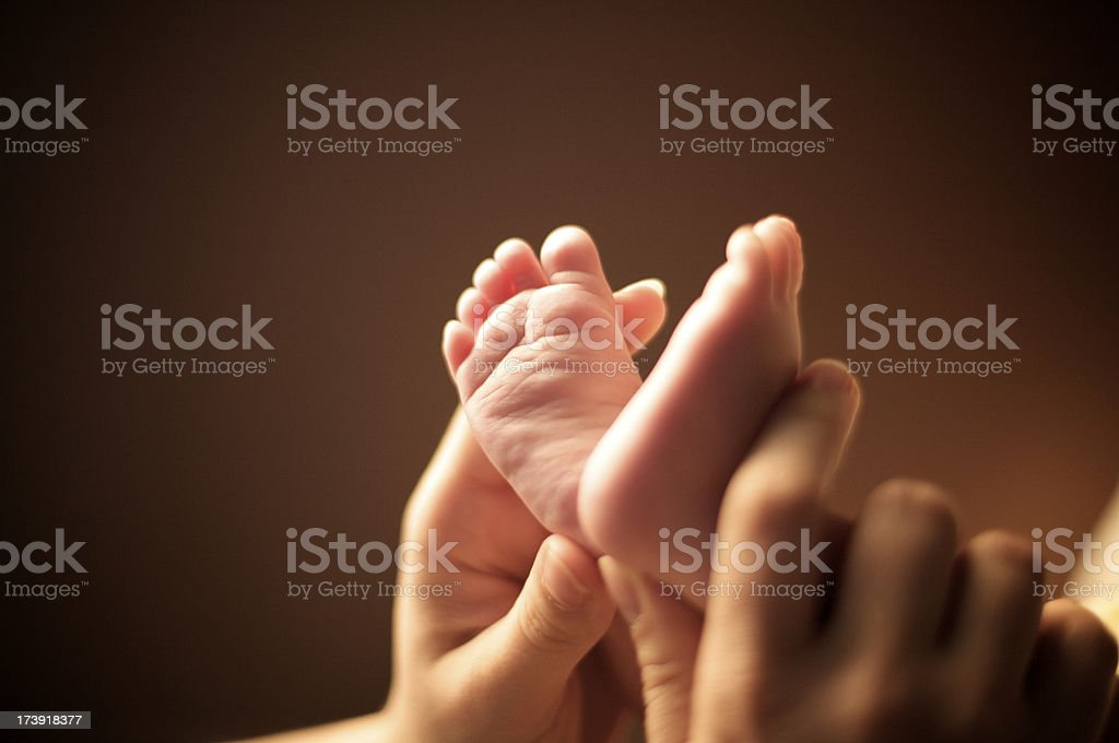 baby feet and mother's hand royalty-free stock photo