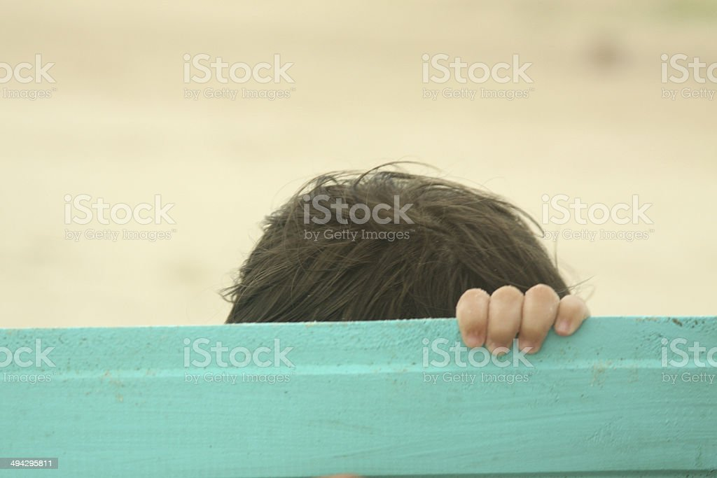 Baby first year playing beach sea toy boat stock photo