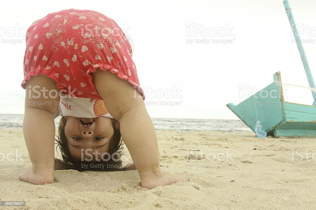 Baby first year playing beach sea toy boat smiles stock photo