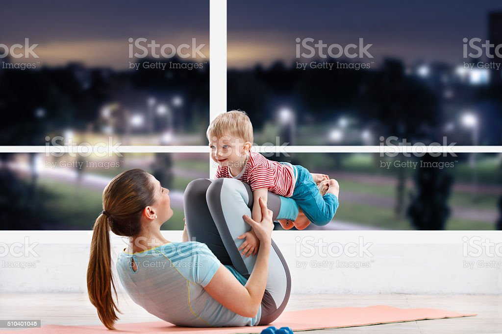 Baby fitness with mom stock photo