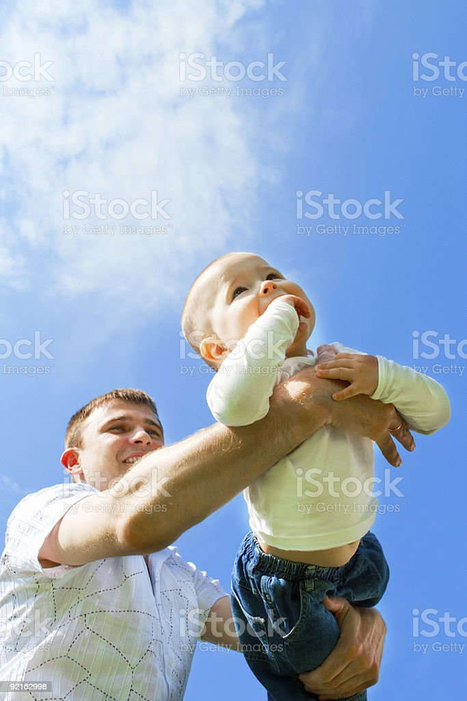 Baby flying on father's hands royalty-free stock photo