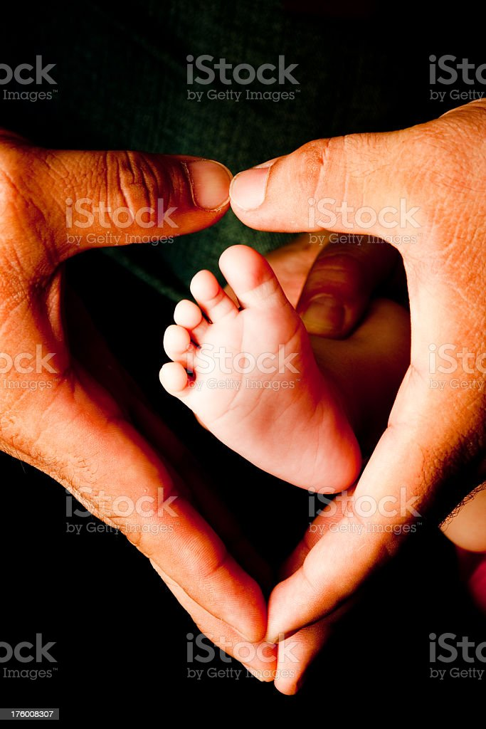 Baby Foot, Daddy's hands royalty-free stock photo