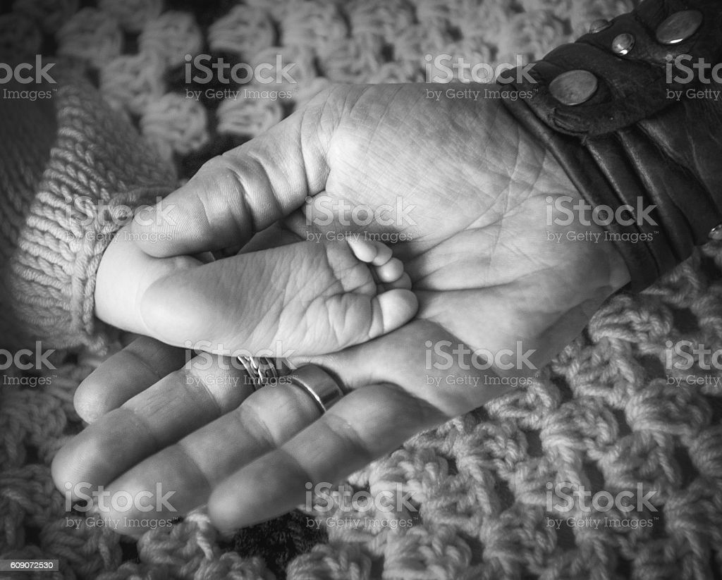 Baby Foot in Fathers Hand stock photo