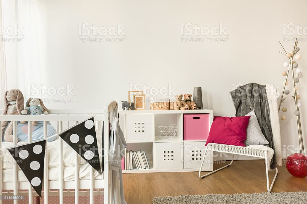 Baby furniture in girl's room stock photo