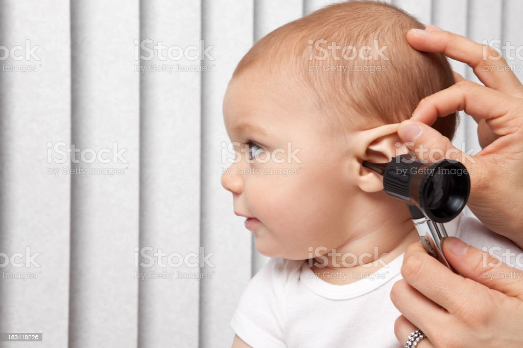 Baby Getting Ear Checked With Otoscope stock photo