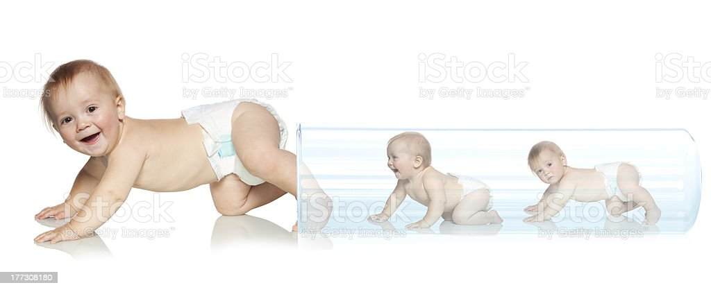 Baby getting out of the tube stock photo