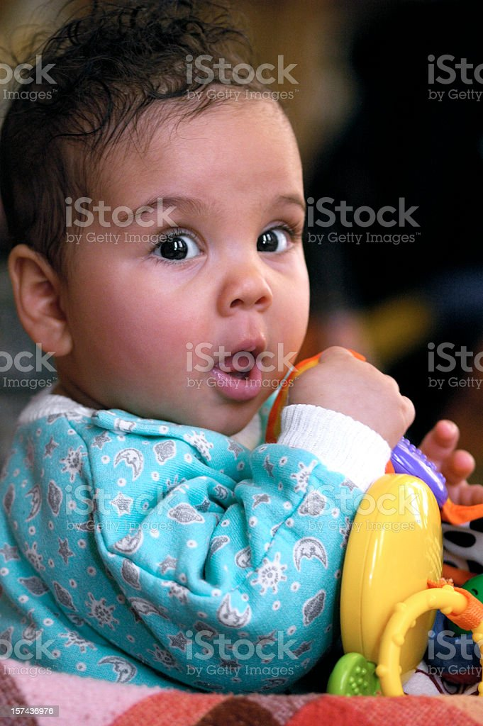 Baby Girl age 6 months old Playing royalty-free stock photo