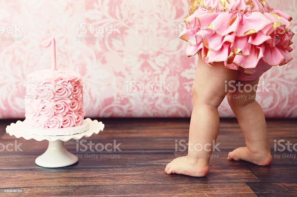 Baby Girl and Birthday Cake stock photo