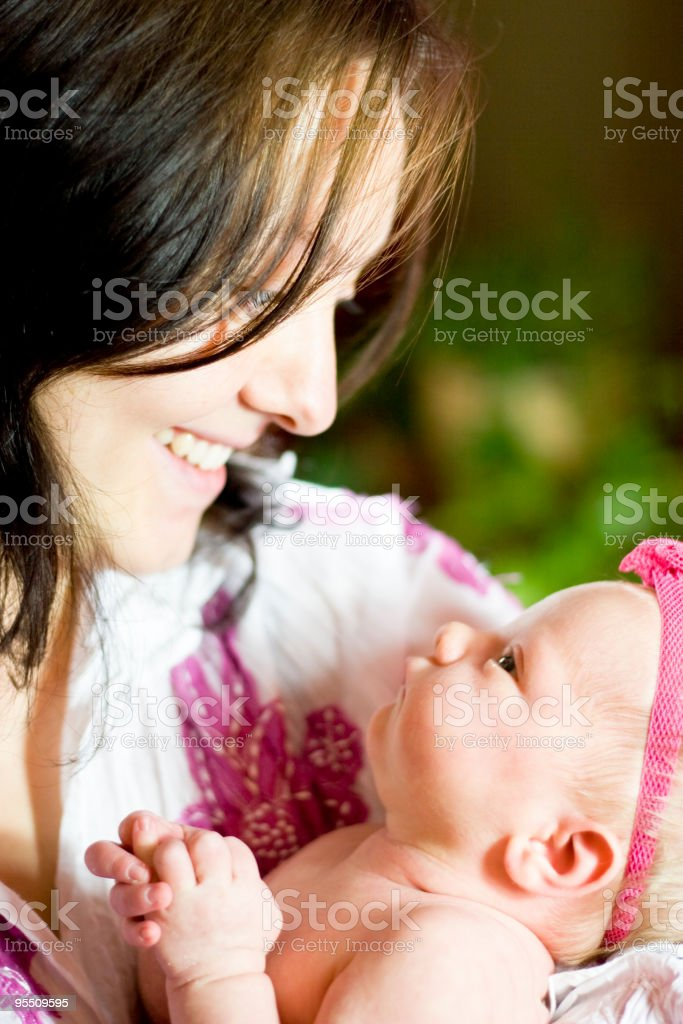 Baby girl and mommy stock photo