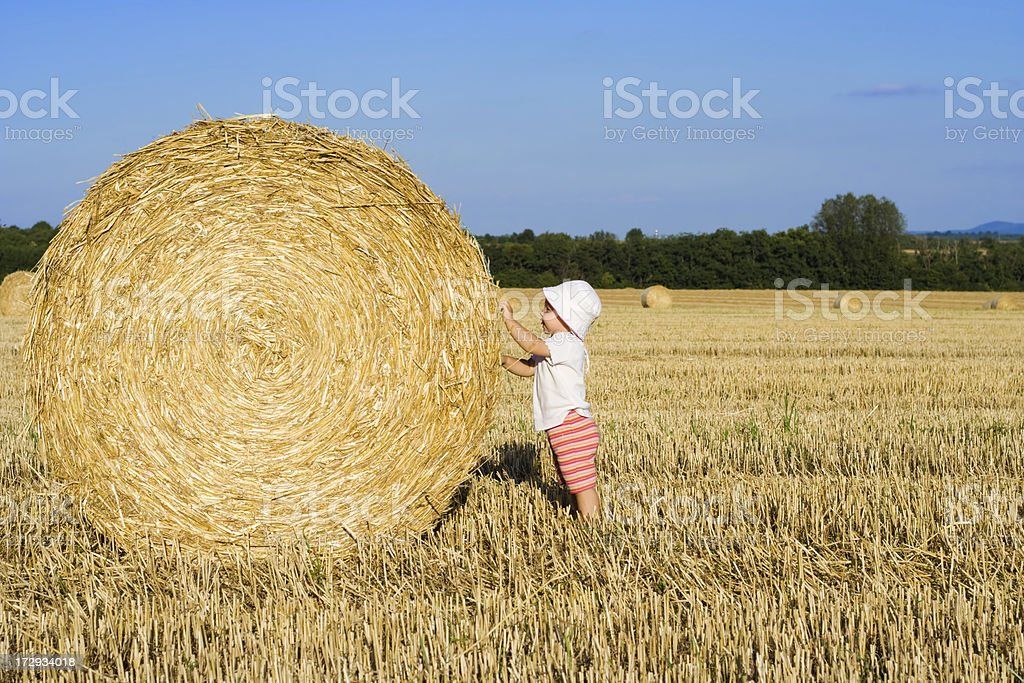 baby girl and the straw bale royalty-free stock photo