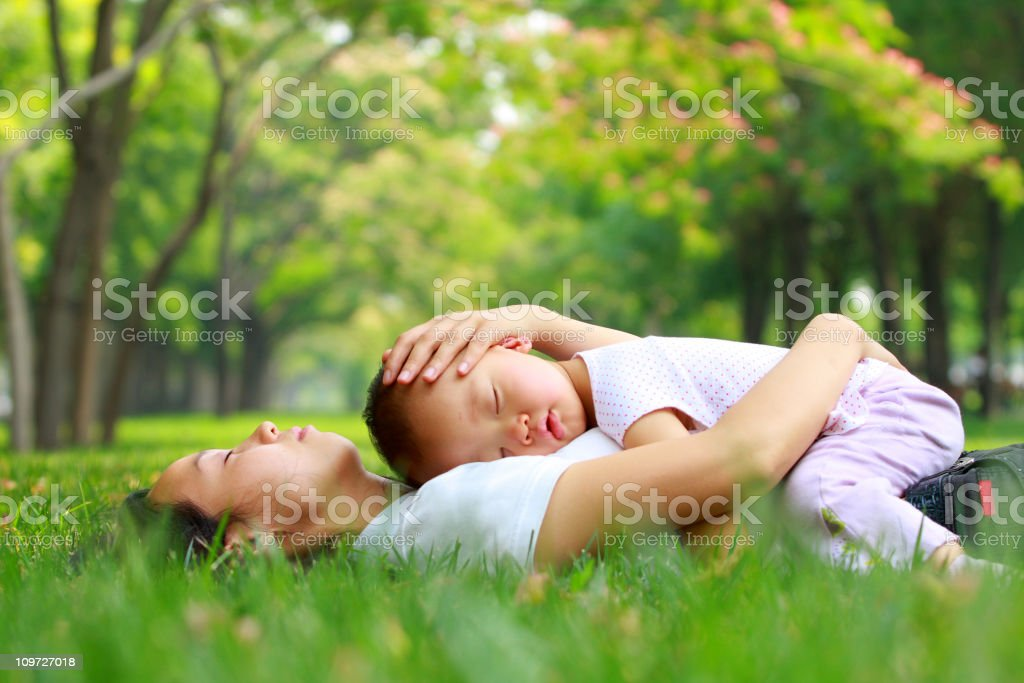 baby girl asleep on mom's chest in the garden royalty-free stock photo
