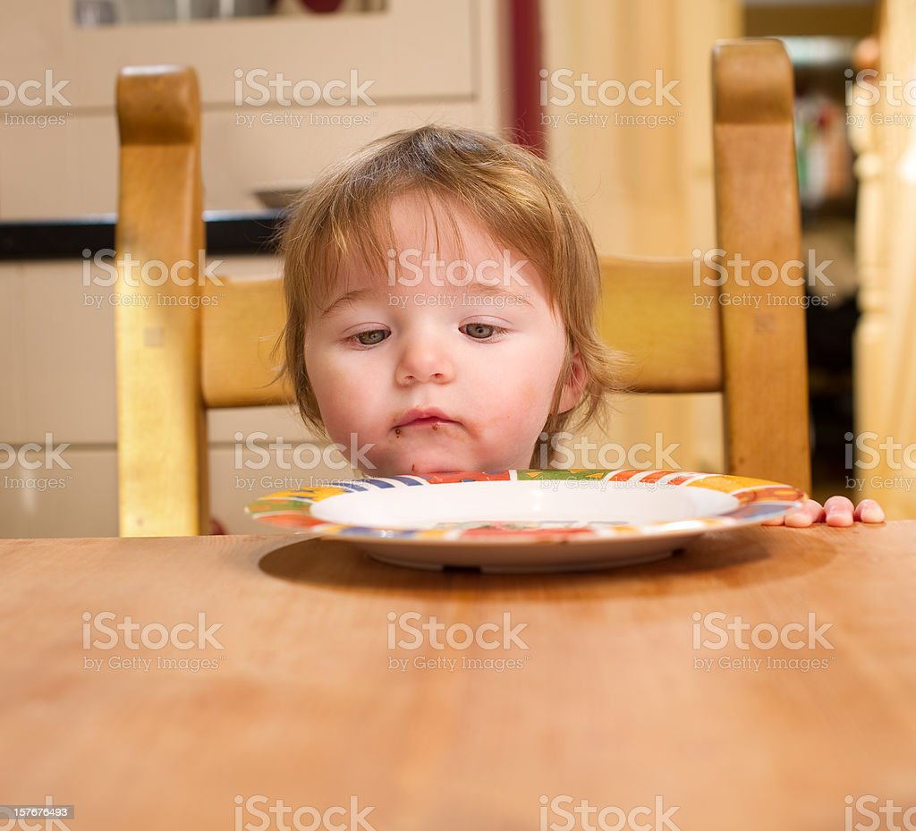 Baby Girl at the Kitchen Table stock photo