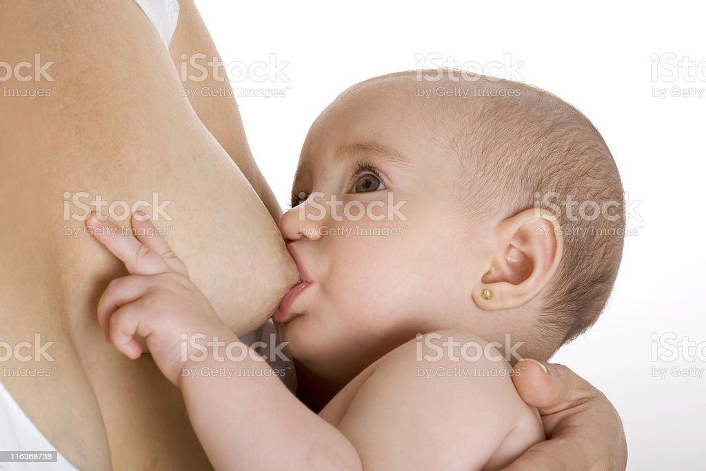 Baby girl breastfeeding stock photo