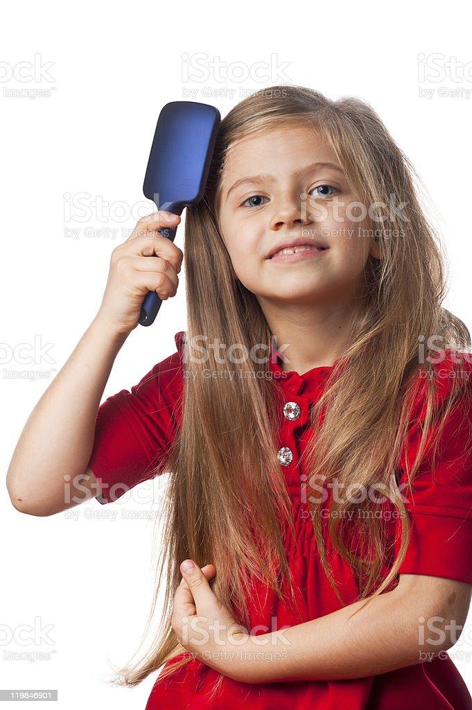 Baby girl brushing her hair royalty-free stock photo