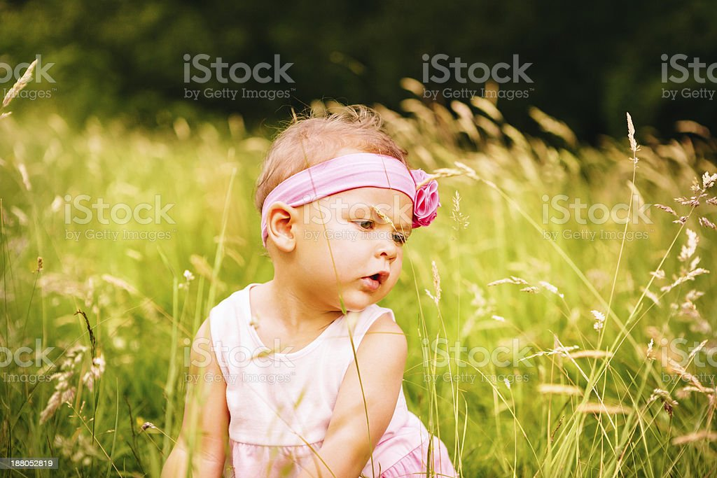 Baby girl busy discovering the world royalty-free stock photo