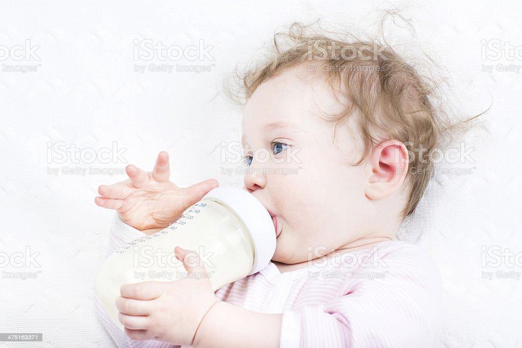 Baby girl drinking milk stock photo