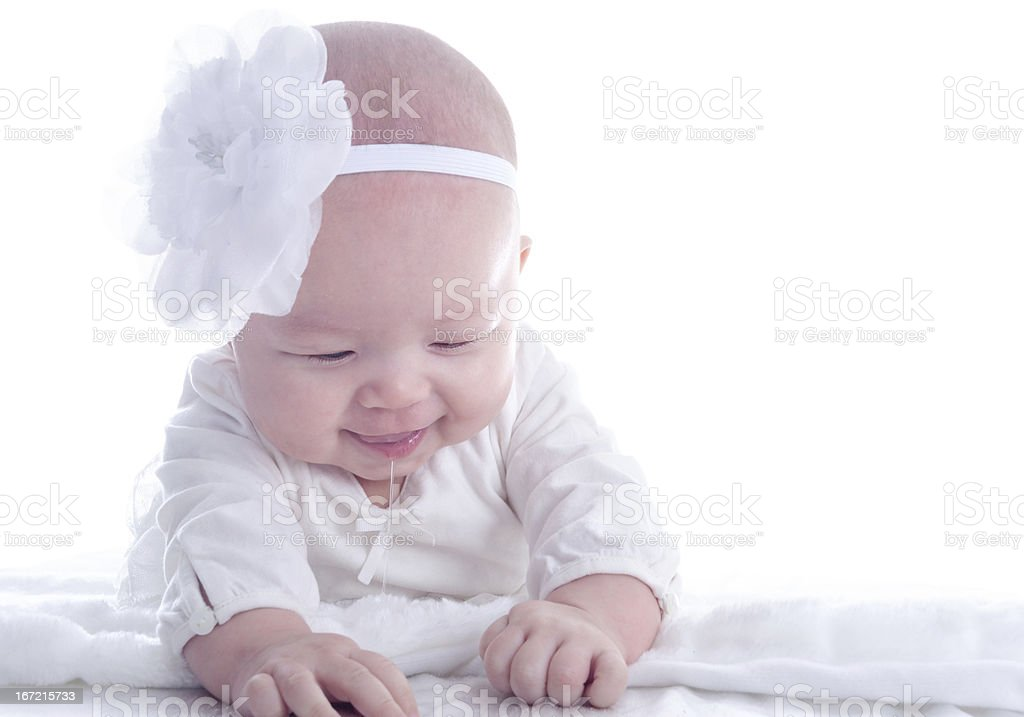 Baby girl (4.5 months) drooling and exploring. royalty-free stock photo