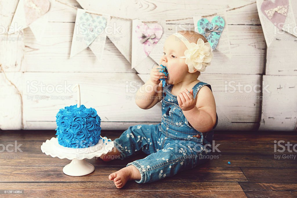 Baby Girl Eating Birthday Cake stock photo