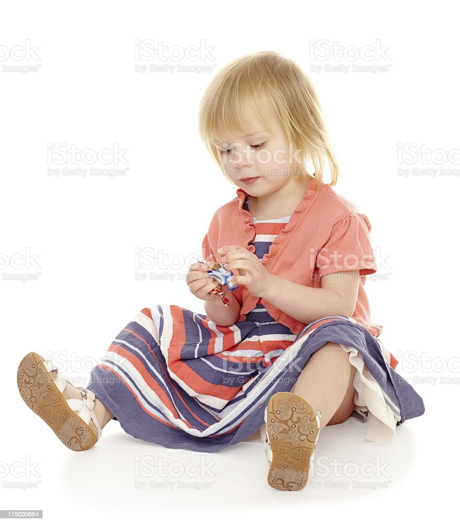 Baby girl eating chocolate on white royalty-free stock photo