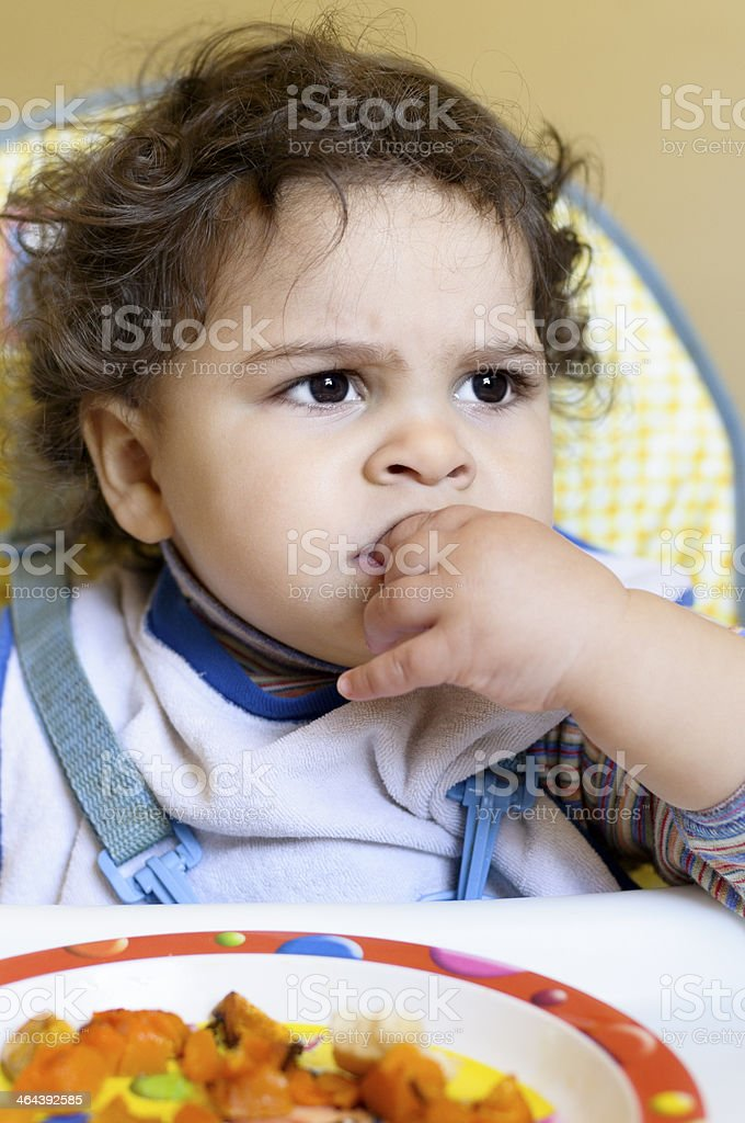 Baby Girl Eating On Her Own, Using Fingers. royalty-free stock photo
