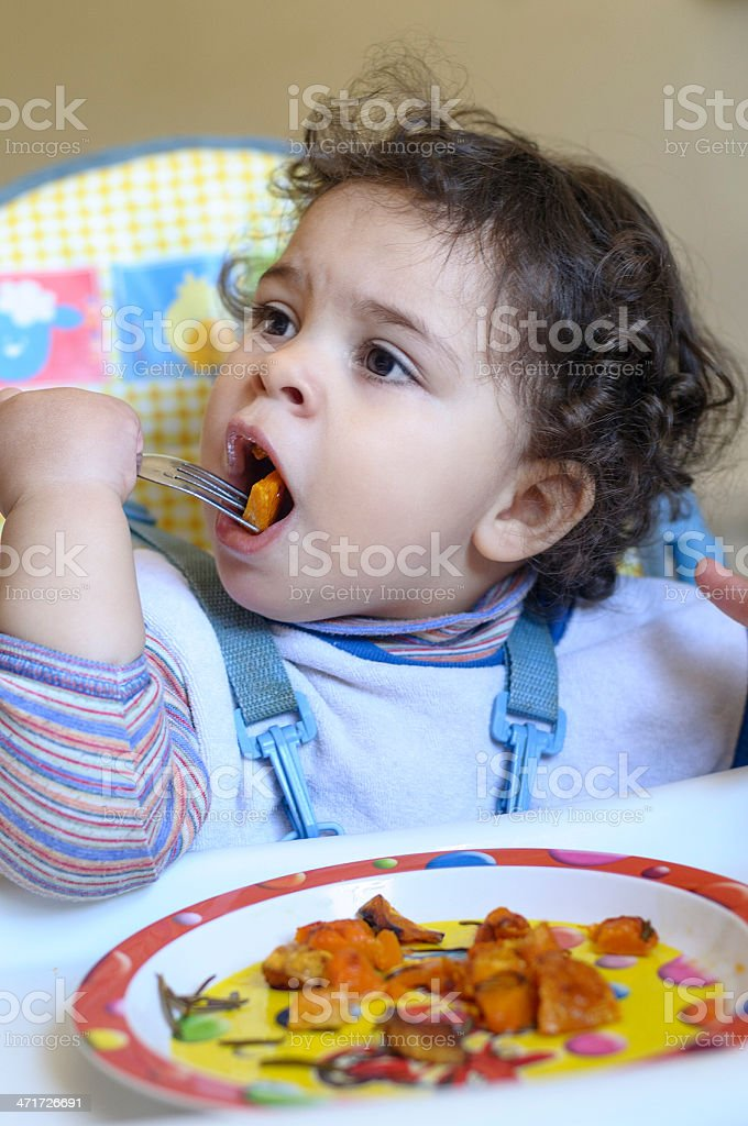 Baby Girl Eating On Her Own, Using Fork royalty-free stock photo