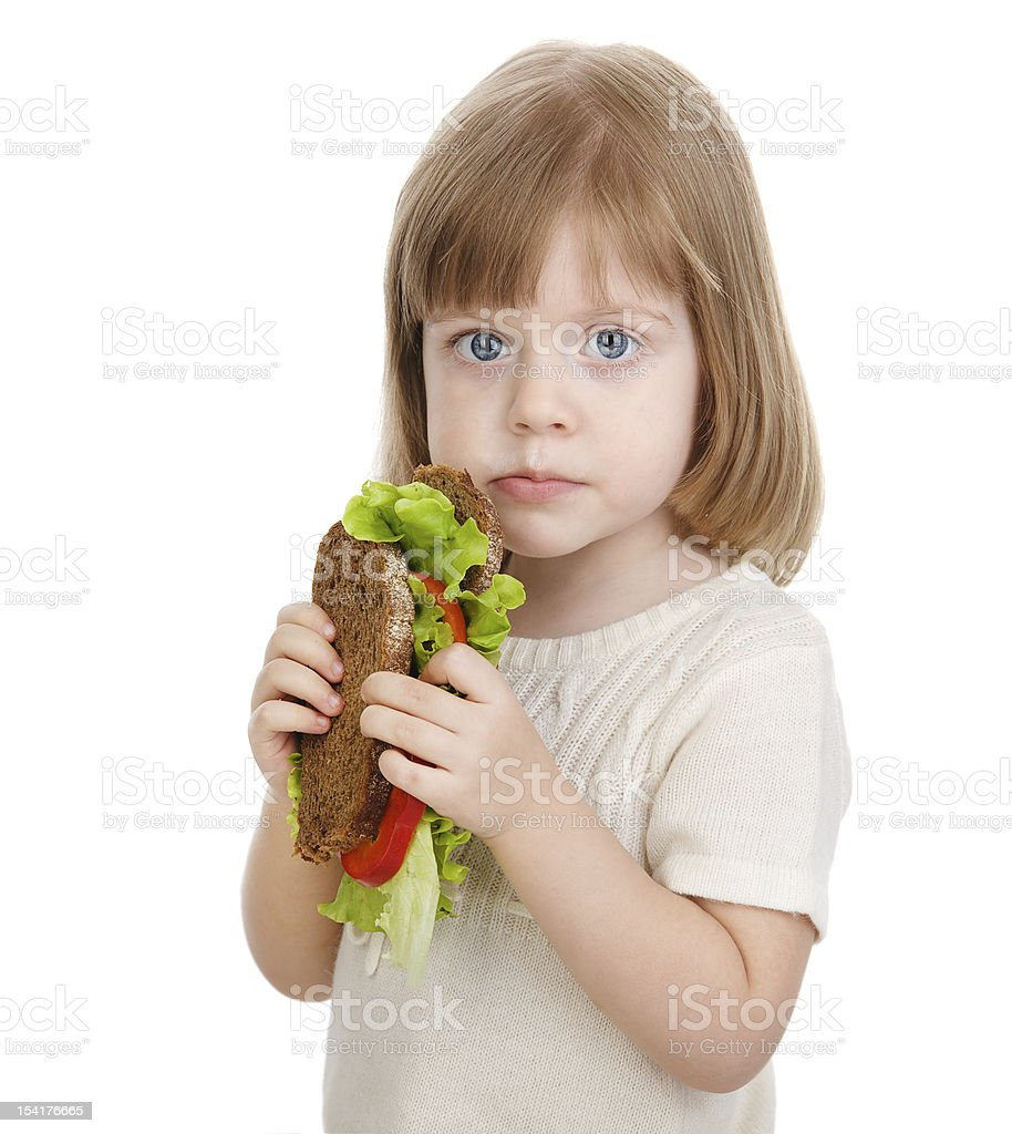 baby girl eating sandwich royalty-free stock photo