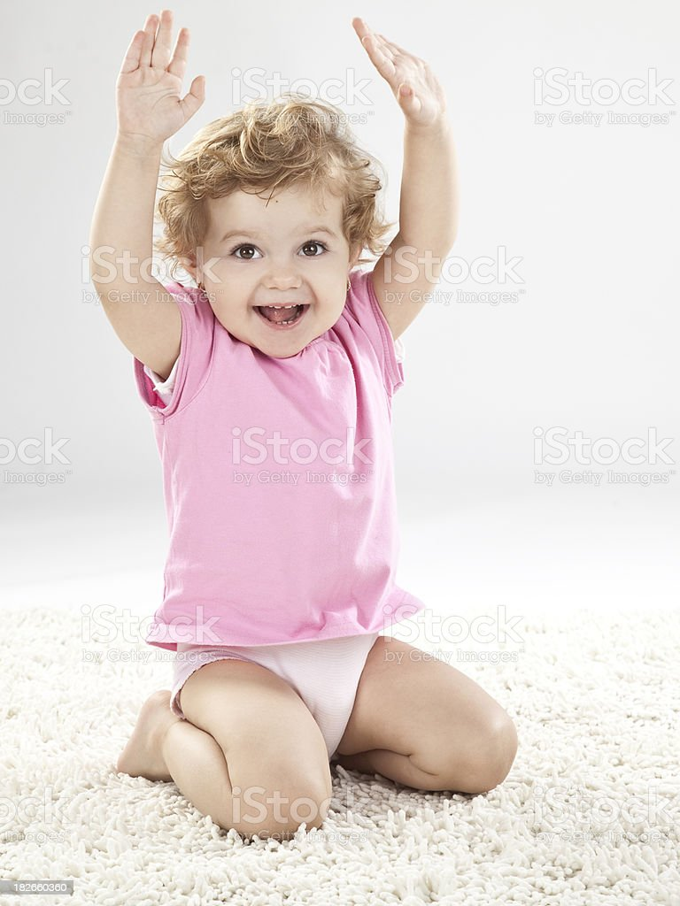Baby girl Hand Raised stock photo