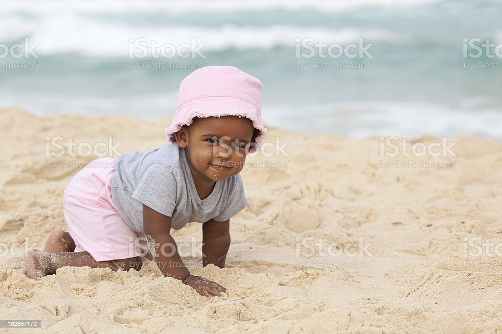 Baby girl have a fun on the beach. stock photo