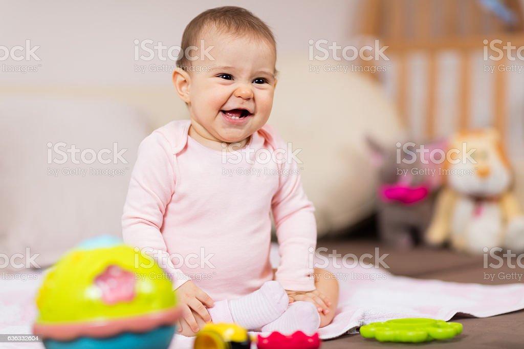 Baby girl having fun at home stock photo