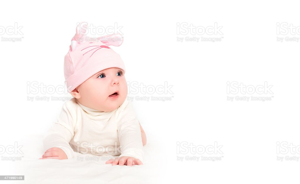 baby girl in a pink hat with rabbit ears isolated royalty-free stock photo