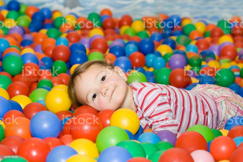 Baby girl in ball pit royalty-free stock photo