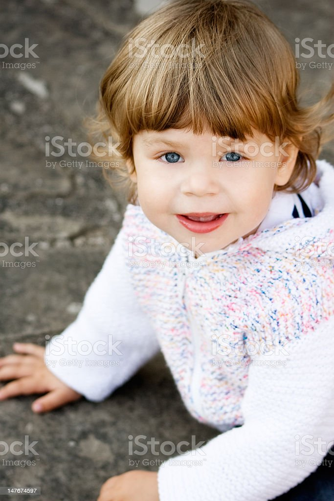Baby Girl in Knitted White Cardigan stock photo