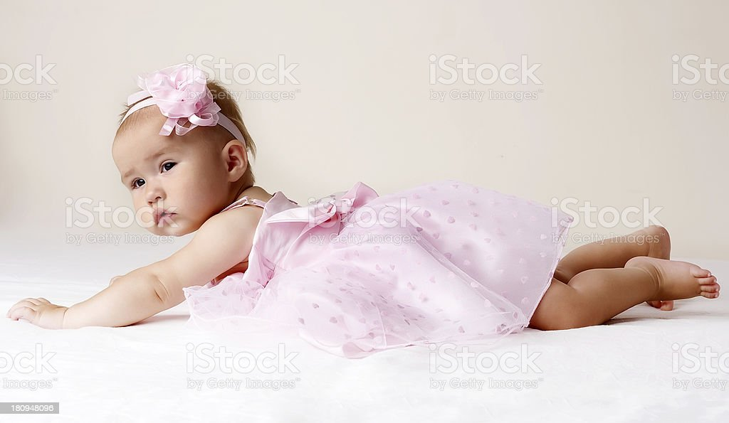 Baby girl in pink dress. royalty-free stock photo