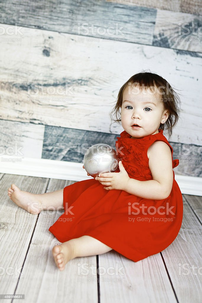 Baby Girl in Red Dress with Christmas Ball royalty-free stock photo