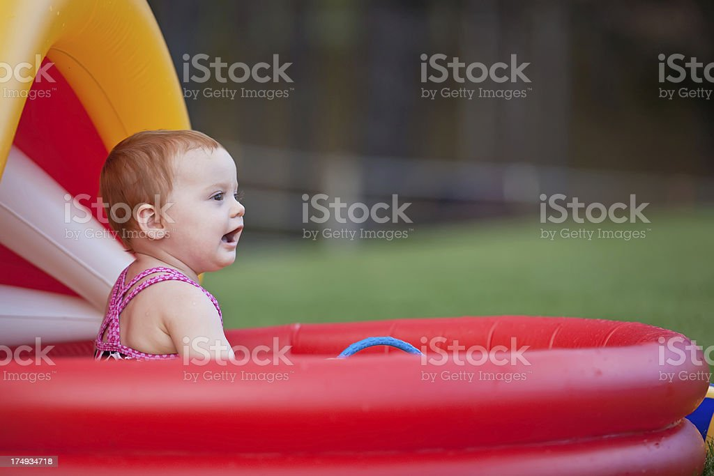 Baby Girl in Swimming Pool royalty-free stock photo