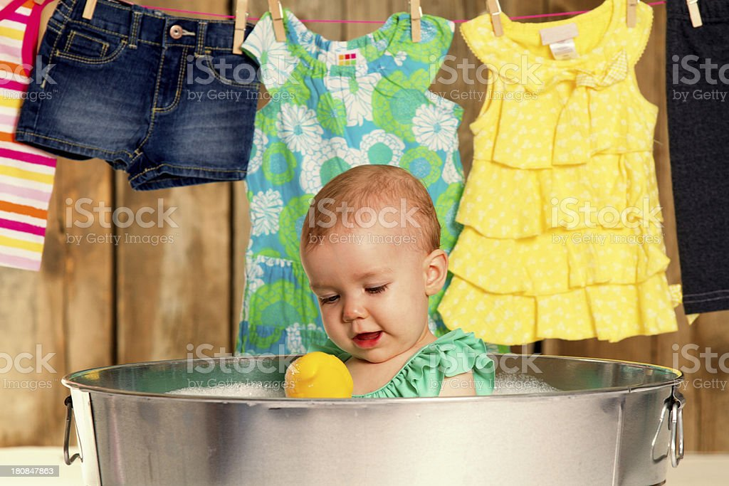 Baby girl in washtub royalty-free stock photo