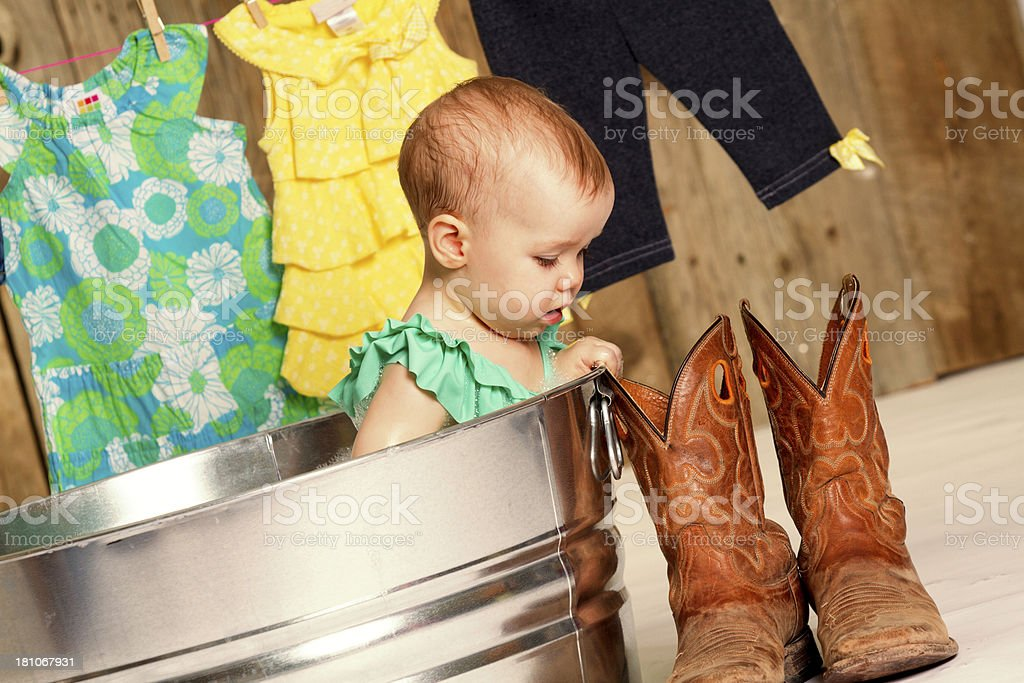 Baby girl in washtub royalty-free stock photo
