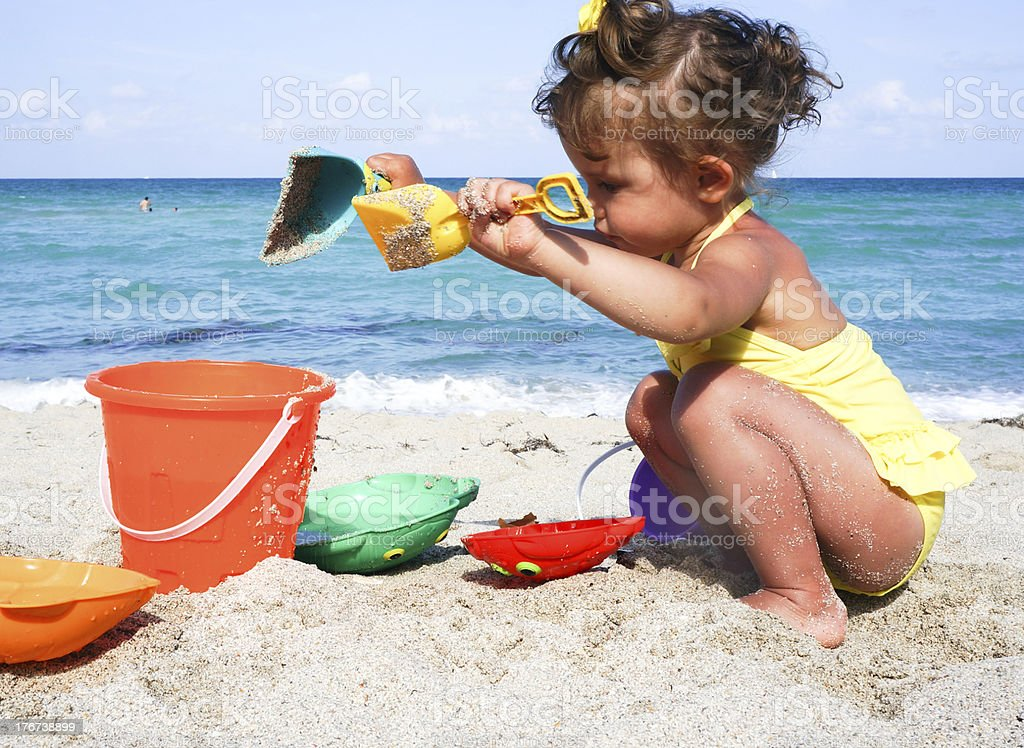 baby girl is having fun at the beach royalty-free stock photo
