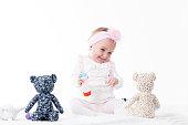 Baby girl laugh with teddy bear