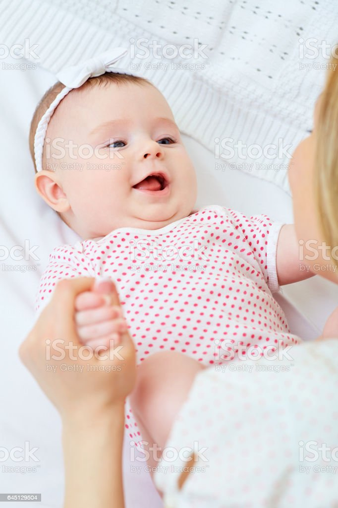 Baby girl laughing smiling with her mother playing stock photo